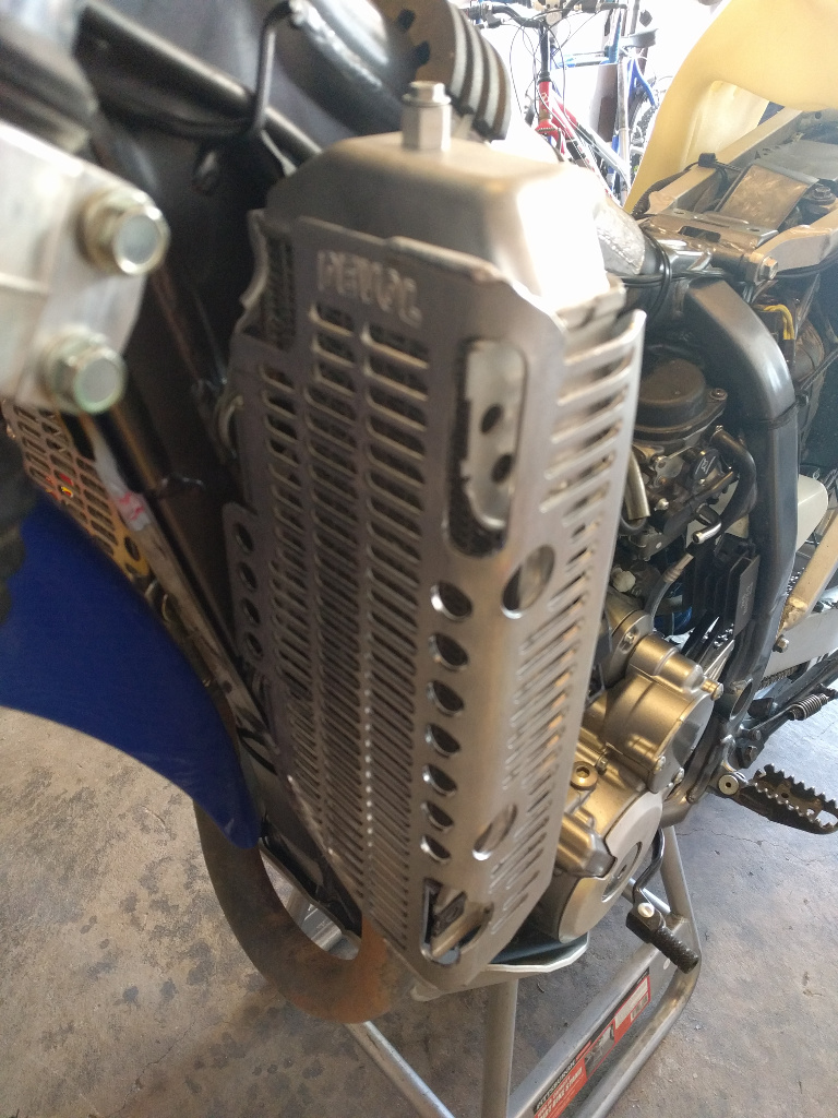 Installing an IMS 4 0 gallon tank and Devol radiator guards